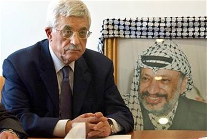Abbas and picture of his mentor Arafat