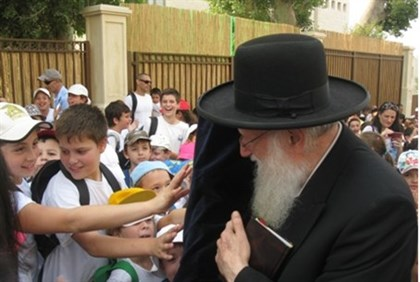 Children kiss Torah scroll they helped write