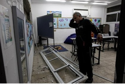 Man surveys rocket damage at Ashdod school