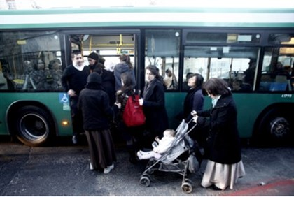 Women boarding bus.