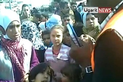Syrian children speak with Arab League observers