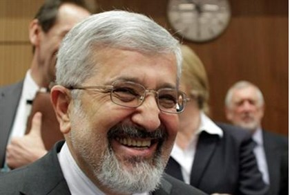 Iran's IAEA envoy Ali Asghar Soltanieh smiles at IAEA meeting