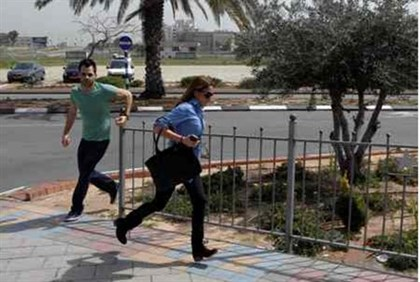 Israelis run for cover from rocket attack