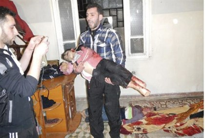 Man Carrying Body of Child in Homs, 12 March 12