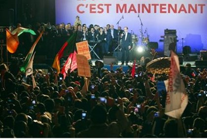 Celebrants at Hollande victory rally wave foreign flags