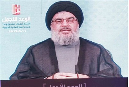 Nasrallah addresses supporters via a screen
