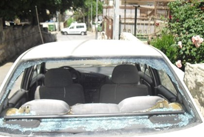 Aftermath of rock attack on Ephraim Silverberg's car