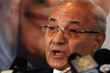 Ahmed Shafiq talks during a news conference in Cairo