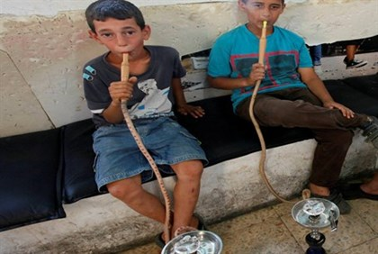Boys smoking hookahs