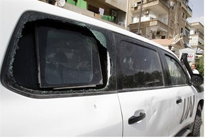 Shattered window on UN vehicle in Damascus