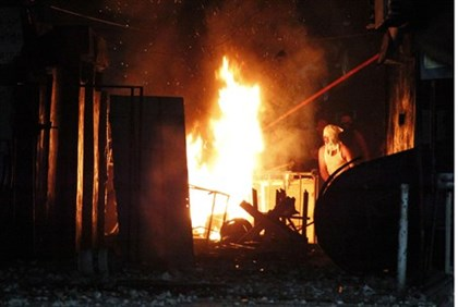 PA Arab sets fire to a checkpoint at the Ain al Hilweh refugee camp