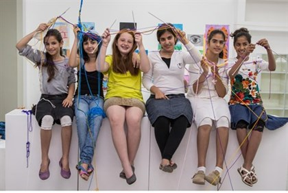 Some members of the Sderot knitting club, including Noa, third from left