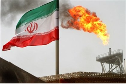 Gas flares from Iranian oil production platform in Persian Gulf