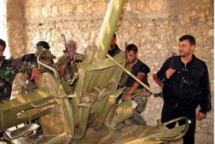 Syrian rebels inspect captured weapons