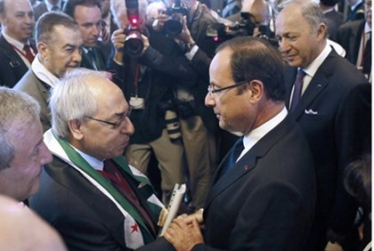 French President Francois Hollande (2nd R), leader of the Syrian National Council (SNC) Abdel Basset