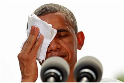 Obama wipes off perspiration at campaign event in Ohio