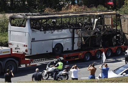 Removing remains of attacked bus near airport