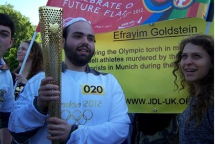 Goldstein carries Olympic Torch