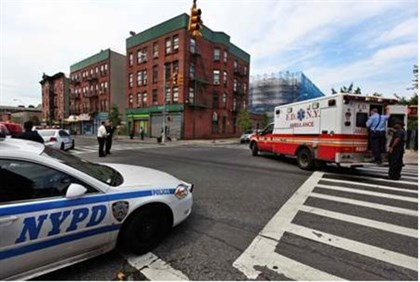 New York police car and ambulance at scene of Brooklyn shooting