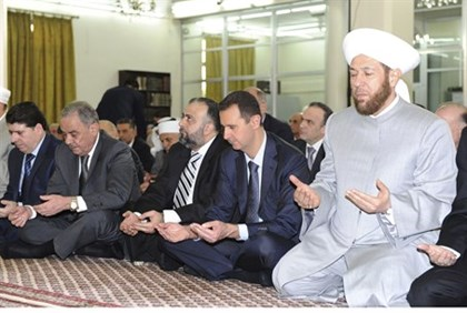 Syria's Assad praying in Damascus mosque for Eid al-Fitr