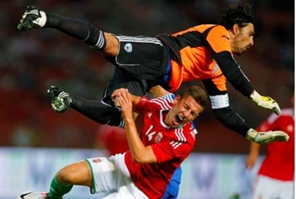 Hungary's Krisztian Nemet (front) fights for the ball with Israel's goalkeeper Dudu Aouate