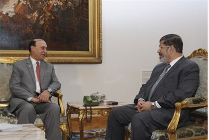 Egypt's President Mohamed Mursi meets with Egypt's newly appointed chairman of the Suez Canal Author