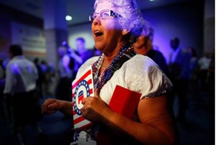 A delegate is interviewed by a member of the media at a Republican National Convention kickoff party