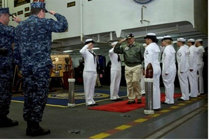 Sideboys render honors to Panetta as he arrives aboard the USS John C. Stennis