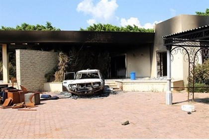 A burnt house and a car are seen inside the US Embassy compound in Benghazi