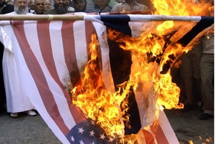 Lebanese Muslims burn a U.S. flag during a demonstration in Sidon