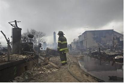 Firefighter stands in Breezy Point after Hurricane Sandy