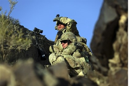 U.S. soldiers observe the area as they expect a Taliban attack