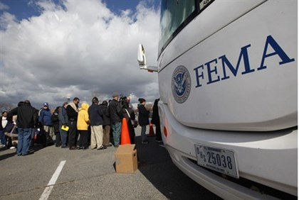 People wait in line to meet with FEMA officials in Coney Island, New York