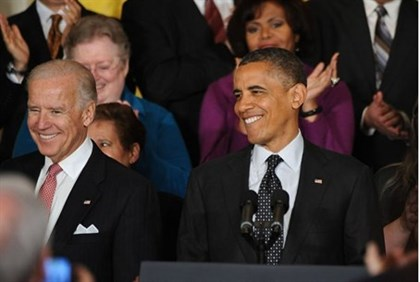 Obama and Biden in the East Room of the White House
