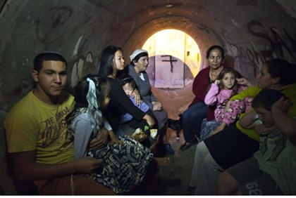 Israelis find shelter from the rockets in a sewage pipe