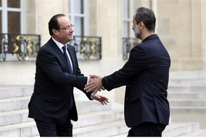 French President Francois Hollande welcomes Syrian opposition chief Ahmed Moaz al-Khatib