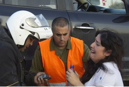 Woman reacts to rocket attack, Ofakim.
