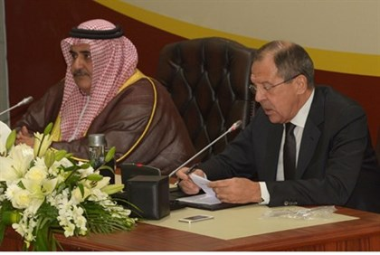 Bahrain's Foreign Minister Khalid Bin Ahmed Bin Mohammed Al Khalifa (L) and Russian Foreign Minister