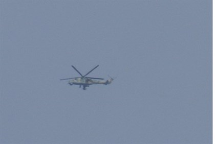 Syrian Army helicopter flies over Houla, near Homs