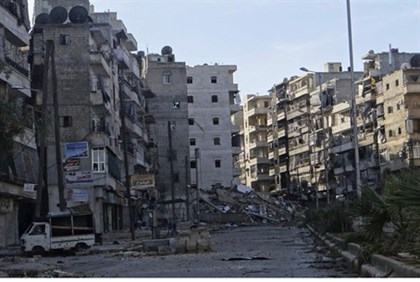 Damages on an empty street in the Aleppo district of Salaheddine