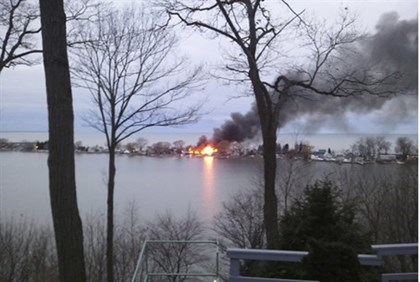 A fire burns on Lake Road in Webster