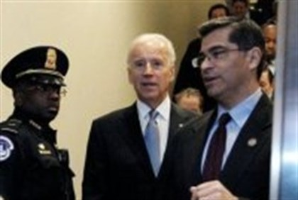 US Vice President Joe Biden arrives with Rep. Xavier Becerra (R) to the US Capitol