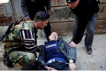 Ayman al-Sahili, a Reuters cameraman, shot in the leg by Assad's loyalsts in Aleppo