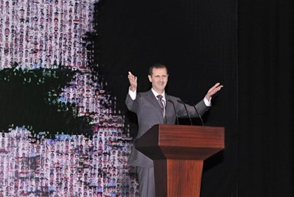 Syria's President Bashar al-Assad speaks at the Opera House in Damascus