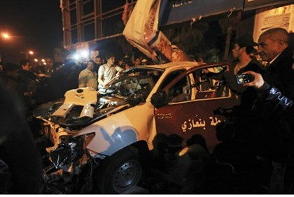 wreckage of a police car following Benghazi attack