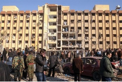 Syrians gather at the scene of an explosion outside Aleppo University
