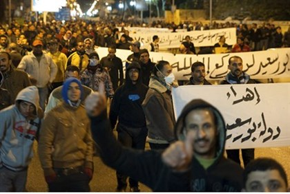 Protesters march during a nighttime curfew in the city of Port Said