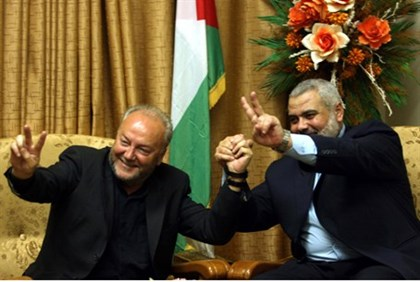 Hamas Prime Minister Ismail Haniyeh meets with British MP George Galloway
