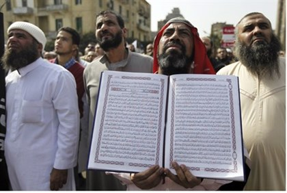 Egyptian Salafist holds copy of Koran