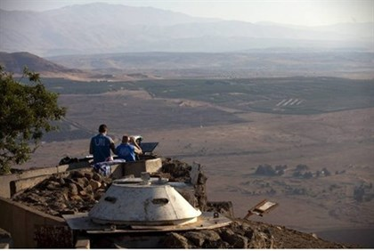 UN peacekeepers monitor the Syrian side of the border